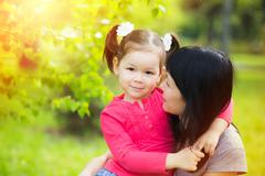 Portrait of mother and daughter. Mom hugging with little child in summer Kuvituskuvat