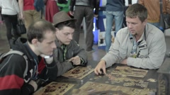 People play board games Munchkin Stock Footage