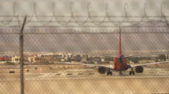 Two airplanes leaving Las Vegas airport Stock Footage