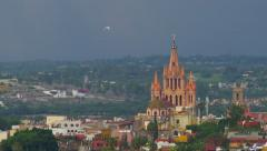 City view of the Parroquia church in San Miguel de Allende sunset with egrets Stock Footage