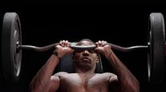 Muscular black man shoulder pressing Stock Footage
