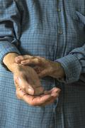 Stock Photo of Elderly hand measuring her own arm pulse.