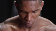 Muscular black man looking serious Stock Footage