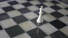 4K King Piece Alone On Chess Board - stock footage