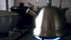 Tea Kettle with Steam Over A Hot Gas Stove Arkistovideo