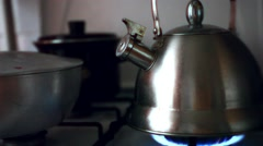 Tea Kettle with Steam Over A Hot Gas Stove Stock Footage