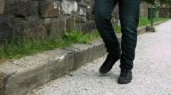 Stock Video Footage of Walking alongside a curb