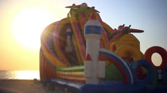 Primorskiy kray, RUSSIA, 03 september, 2014. Kids playing on Inflatable slides Stock Footage