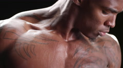 Muscular black man curling free weights Stock Footage