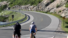 Two Bicyclists on a winding road Stock Footage