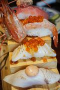 Authentic and traditional Japanese sushi with various kinds of fresh raw fish - stock photo