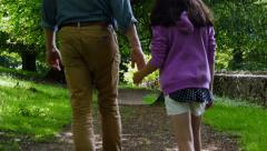 Father and daughter holding hands walking, 4k, UHD Stock Footage