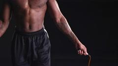 Muscular black man jumping rope Stock Footage