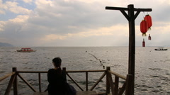 Woman enjoying the landscape of Erhai lake in Dali, China Stock Footage