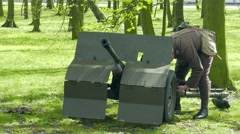 Bofors 37mm gun. An anti-tank gun and soldier in World War II costume Stock Footage