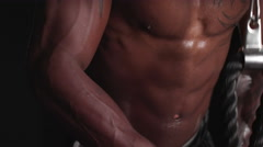 Muscular black man performing a cable pushdown Stock Footage