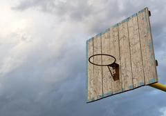 Wooden Basketball Hoop and Grey Sky Stock Photos