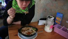 Asian woman eating chinese noodles - stock footage