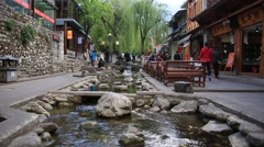 People walking along the canal in Dali old town, Yunnan, China. Stock Footage