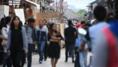 People walking on a busy street in Dali old town, Yunnan, China Stock Footage