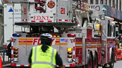 A fire truck and firefighters on the streets of New York Stock Footage