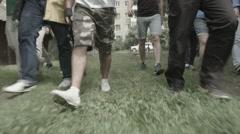 Walking street footbal hooligans going to legs foots Stock Footage