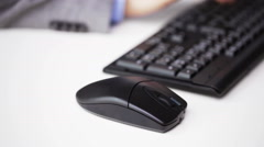 close up of male hand with keyboard and mouse - stock footage