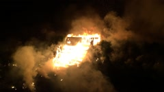 Wooden structure on fire wide view Stock Footage
