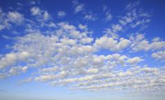 Beautiful cumulus cirrus clouds in blue sky - stock photo