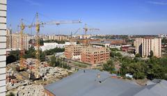 Construction of high-rise apartment brick building Stock Photos