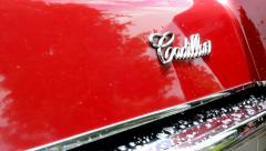 old vintage American car - detail of logo Cadillac - stock footage