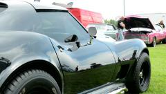 Stock Video Footage of old vintage American black sport car Corvette - side