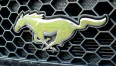 Classic American car - detail of logo Mustang Stock Footage