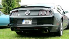 Classic American car black Mustang - back side Stock Footage