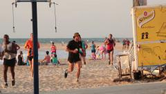 People running on the Beach - stock footage