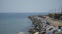 Wave Breaker By A Beach In Summer Stock Footage