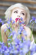 Portrait of lady with iris flowers Stock Photos