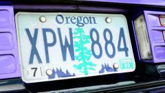 old vintage American car - detail of registration number - stock footage