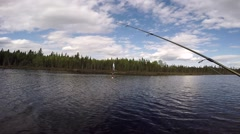 Fishing view with lure in foreground Stock Footage