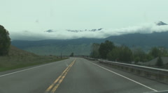 Road toward misty mountains Stock Footage