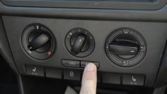 Switching the air conditioning in the car and blow Stock Footage