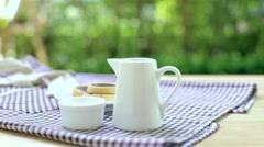 Hand Pouring Hot Tea for Tea Break Stock Footage