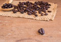 Coffee beans on wooden table background Stock Photos