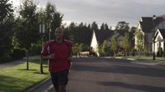 Black Man jogging outside Stock Footage