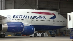LONDON, BA passenger plane is towed into hangar at Heathrow Airport Stock Footage