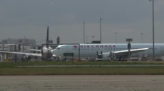 LONDON, Air Canada passenger plane taxis past terminal at Heathrow  Stock Footage
