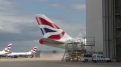 LONDON, British Airlines passenger planes on stands and at hangar  Stock Footage