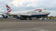 LONDON, BA passenger plane is towed out of shot to hangar at Heathrow Stock Footage