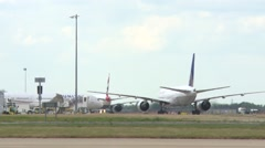 LONDON, Passenger planes wait on busy runway at Heathrow Airport Stock Footage