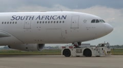 LONDON, South African Airways passenger plane is towed on runway  Stock Footage